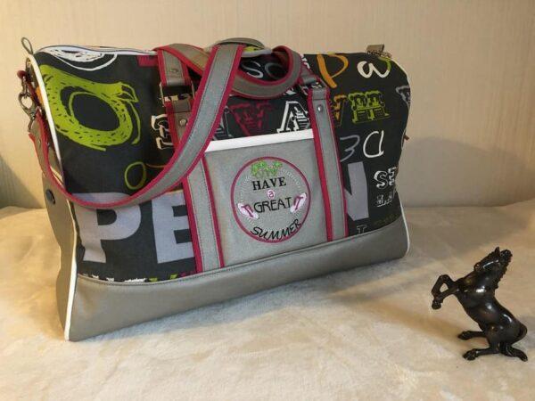 sac de voyage boston rose et gris